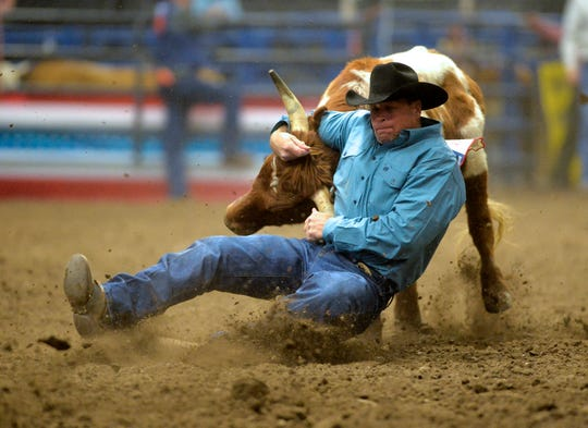 Mike Gollaher competes in the steer wrestling event during a previous Montana Pro Rodeo Circuit Finals in the Four Seasons Arena.