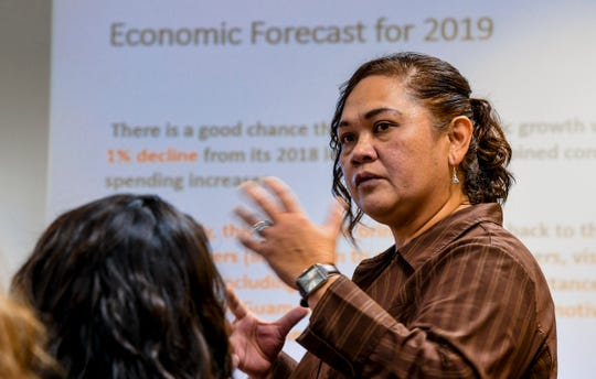Maria Claret Ruane, Professor of Economics, presents the results of a study conducted on the community's economic growth and its possible direction it may take, during a press conference at the University of Guam on Thursday, Dec. 27, 2018.