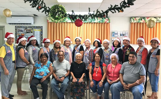 "The Guam Sunshine Lions Club, in keeping with their club's service project of ""Caring for the Sick and the Elderly,"" visited the Agana Heights Senior Citizens Center on December 12, 2018 bringing sweets, treats, and Christmas songs.  Seated from left: Frances Santiago, Johnny Santiago, Adelina Facundo, Edna Arellano, Priscilla Mesa, and Mayor Paul McDonald. Standing from left: Lions Pete Babauta, Tish Tano, Lorraine Rivera, Jill Pangelinan, LouJean Borja, Julie Cruz, Josephine Borja, Helen Mendiola, Connie Rivera, Jovie Mejorada, Linda Villagomez, Johnny Villagomez (Guam Tano-Ta Branch Club), Marietta Camacho, and Dee Cruz."
