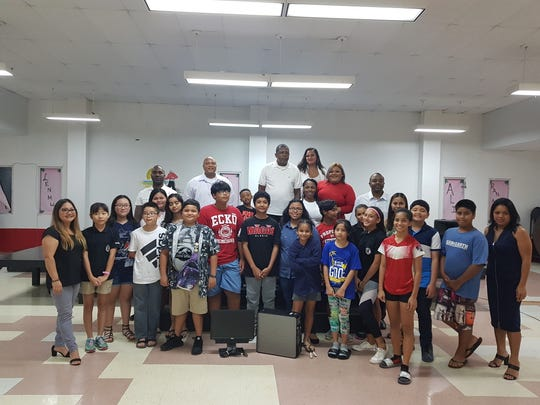 Prince Hall Masonic Family District Eight donated a computer to Agueda I. Johnston Middle School during a PTO meeting on November 28, 2018.