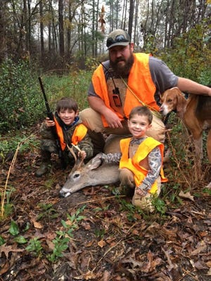 "Easton ""Possum"" Haggart, 7 (left), of Purvis, nailed his first buck while hinting with his brother Reese, 3 (front), and their dad Colby."
