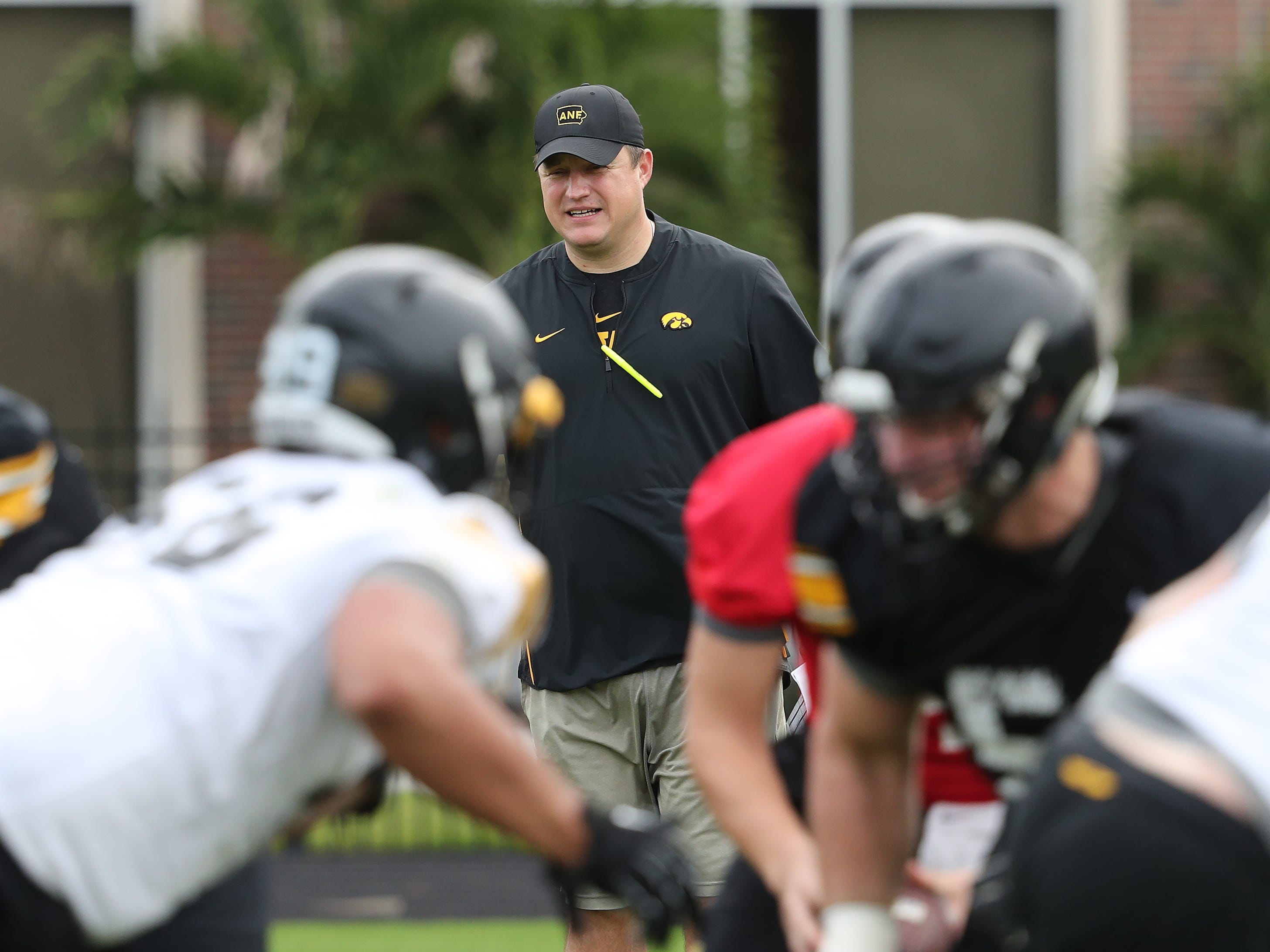 In this University of Iowa photo from Thursday's closed practice, offensive coordinator Brian Ferentz oversees his starting first unit. For more photos, visit HawkeyeSports.com.