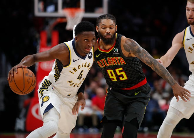 Indiana Pacers guard Victor Oladipo (4) drives to the basket as Atlanta Hawks forward DeAndre' Bembry (95) defends during the second half of an NBA basketball game Wednesday, Dec. 26, 2018, in Atlanta.