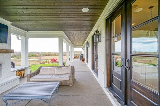 A look at the home's porch and back patio that leads to the open concept kitchen and living room