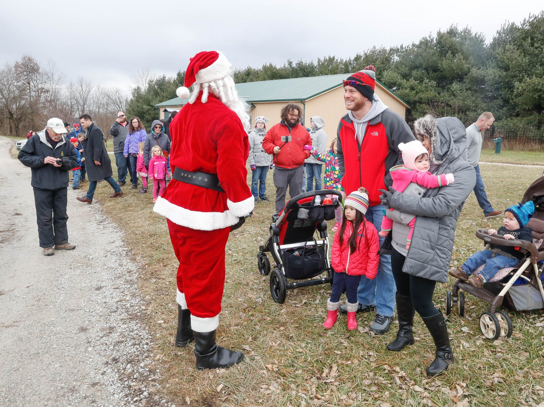 Santa meets guests during his annual visit to Wolf Park in Battle Ground Indiana on Saturday, Dec. 15, 2018.