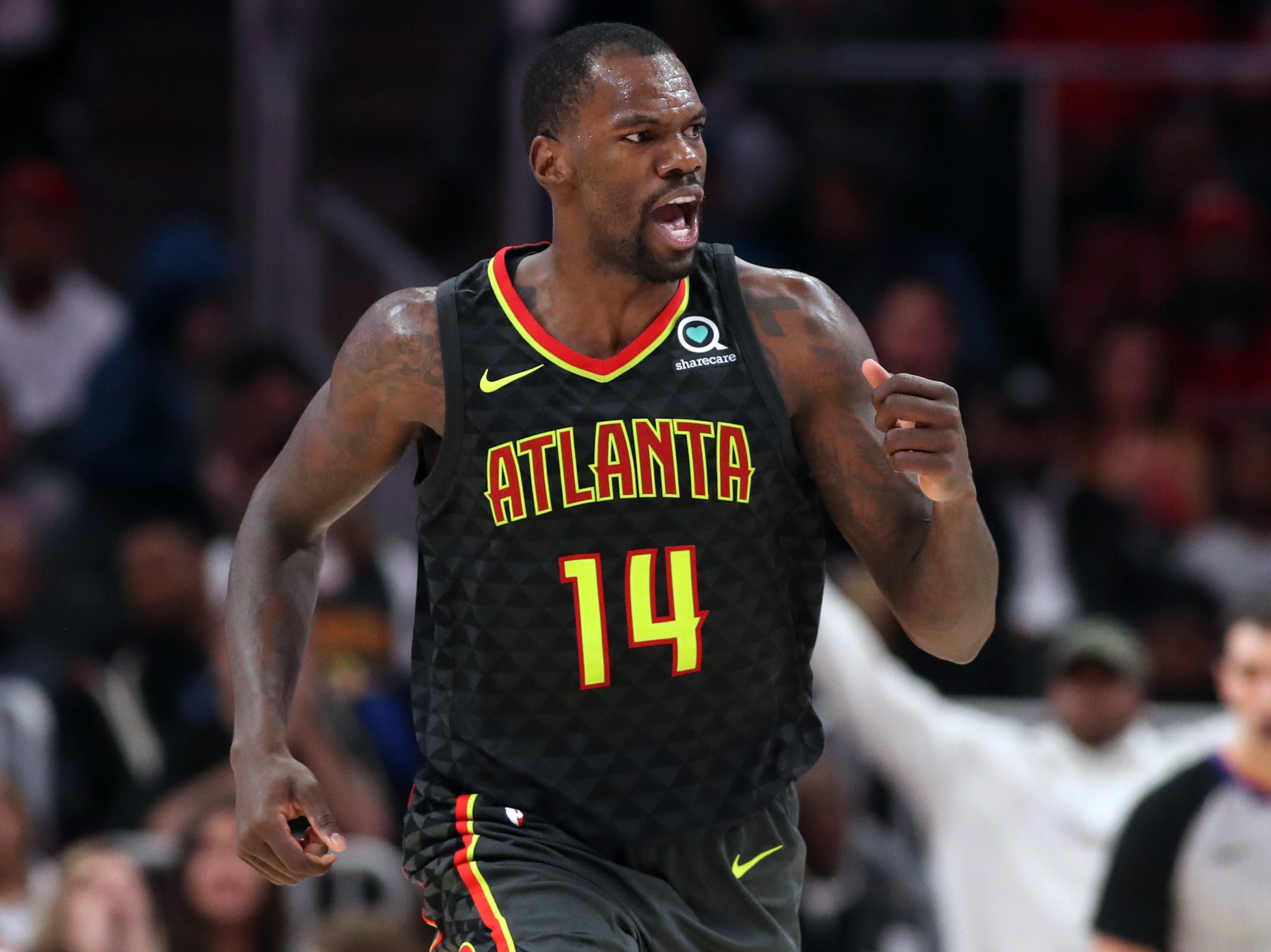Dec 26, 2018; Atlanta, GA, USA; Atlanta Hawks center Dewayne Dedmon (14) reacts after a dunk in the second quarter against the Indiana Pacers at State Farm Arena. Mandatory Credit: Jason Getz-USA TODAY Sports