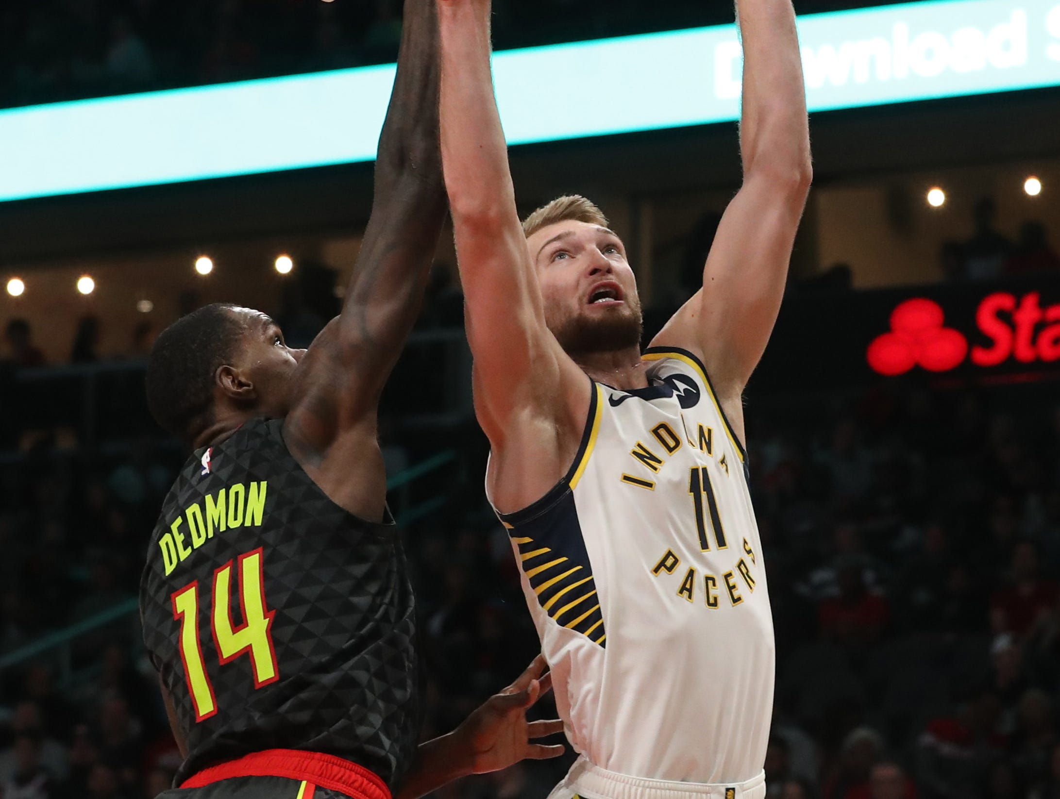 Dec 26, 2018; Atlanta, GA, USA; Indiana Pacers forward Domantas Sabonis (11) attempts a shot against Atlanta Hawks center Dewayne Dedmon (14) in the first quarter at State Farm Arena. Mandatory Credit: Jason Getz-USA TODAY Sports