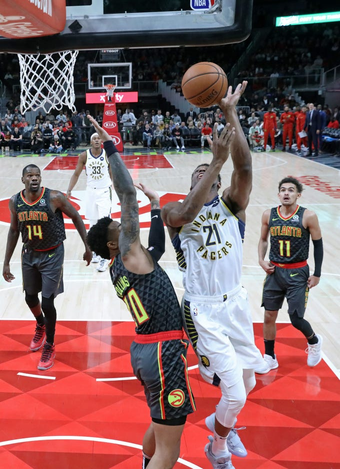 Dec 26, 2018; Atlanta, GA, USA; Indiana Pacers forward Thaddeus Young (21) attempts a shot defended by Atlanta Hawks forward John Collins (20) in the first quarter at State Farm Arena. Mandatory Credit: Jason Getz-USA TODAY Sports