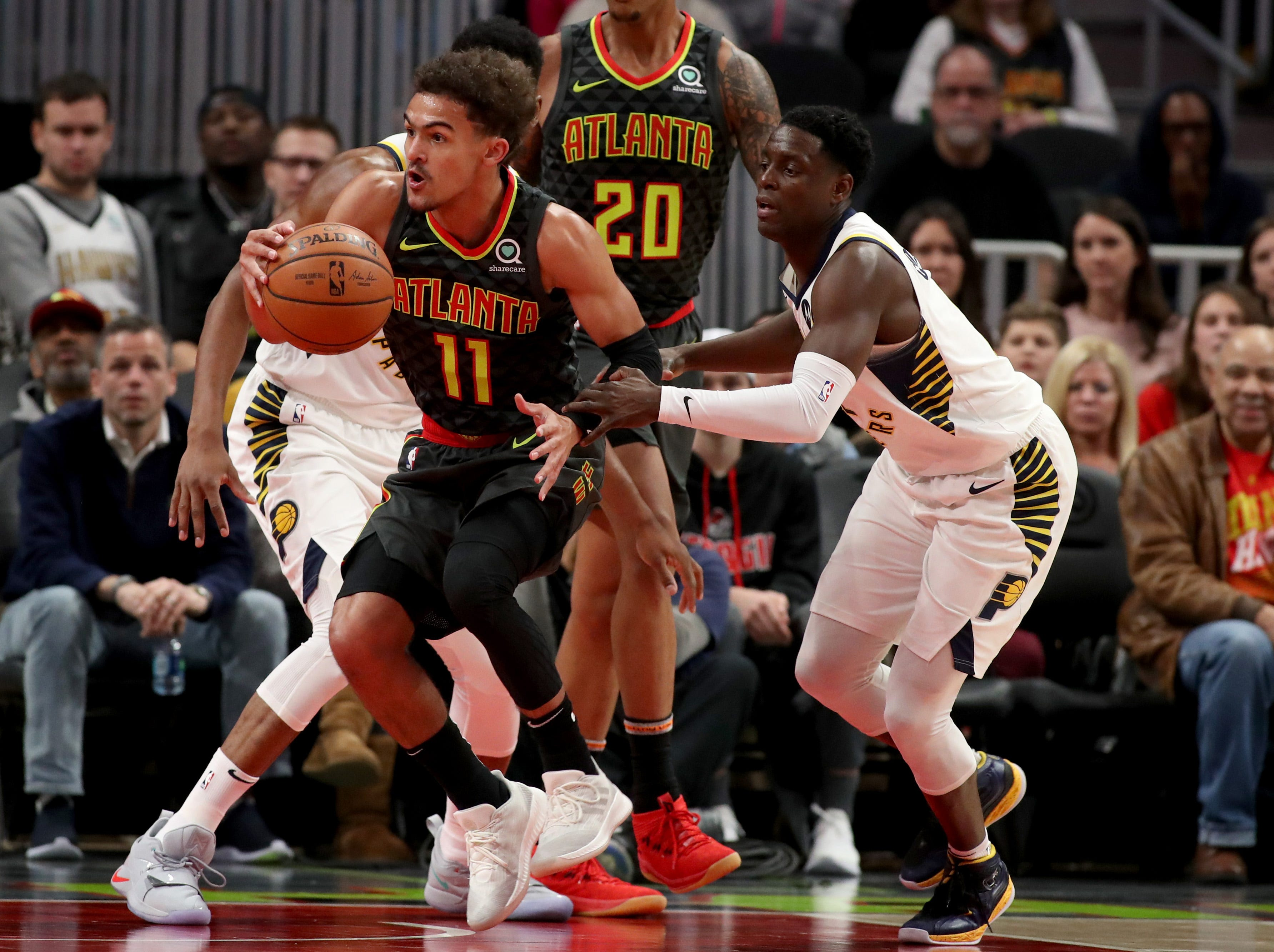 Dec 26, 2018; Atlanta, GA, USA; Atlanta Hawks guard Trae Young (11) drives against Indiana Pacers guard Darren Collison (2) in the first quarter at State Farm Arena. Mandatory Credit: Jason Getz-USA TODAY Sports