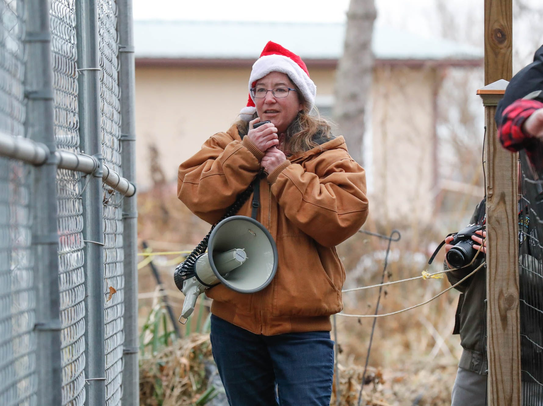 Wolf Park Managing Director, Dana Drenzek leads a holiday tour of Wolf Park during Santa's annual visit in Battle Ground Indiana on Saturday, Dec. 15, 2018.