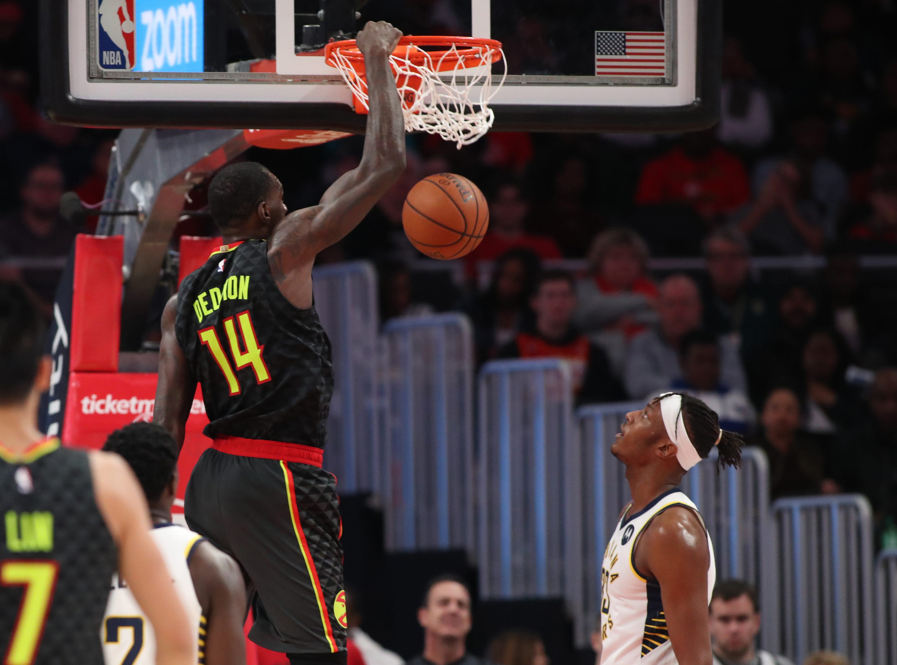Dec 26, 2018; Atlanta, GA, USA; Atlanta Hawks center Dewayne Dedmon (14) dunks in the second quarter against the Indiana Pacers at State Farm Arena. Mandatory Credit: Jason Getz-USA TODAY Sports