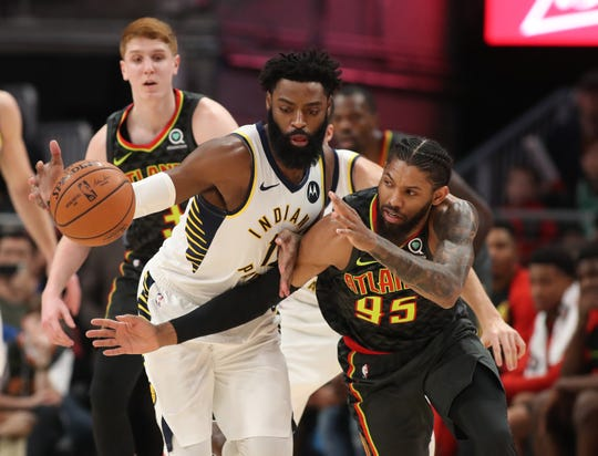 Pacers guard Tyreke Evans (12) steals the ball away from Atlanta Hawks forward DeAndre' Bembry (95) in the first quarter at State Farm Arena.