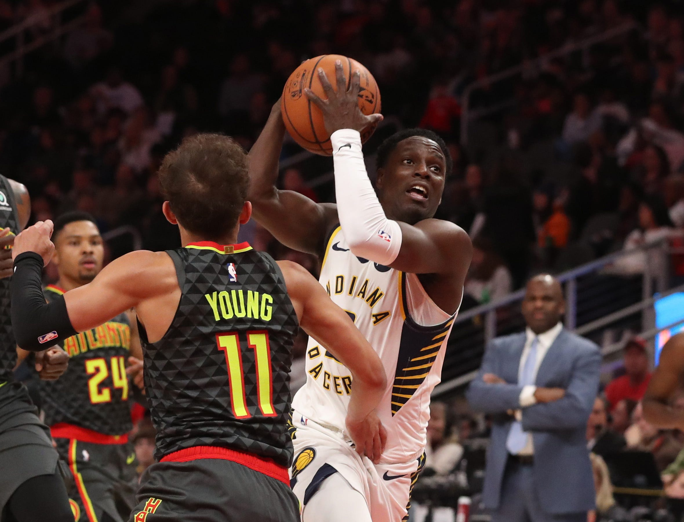 Dec 26, 2018; Atlanta, GA, USA; Indiana Pacers guard Darren Collison (2) drives against Atlanta Hawks guard Trae Young (11) in the first quarter at State Farm Arena. Mandatory Credit: Jason Getz-USA TODAY Sports