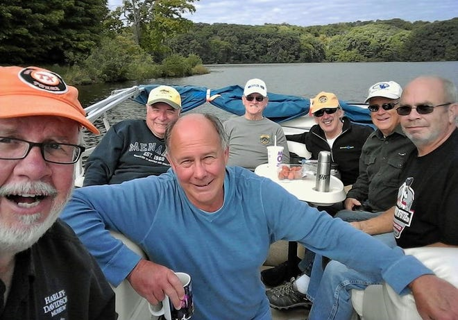 These members of a North Liberty retired guy's coffee group formed through social media over the past three years enjoyed a Lake Macbride tour by pontoon in September.  From left are columnist Dick Hakes, Bill Greazel, Joe Wilkinson, Justin Collier, Wade Swindle, Larry Lee and Bob Olson.
