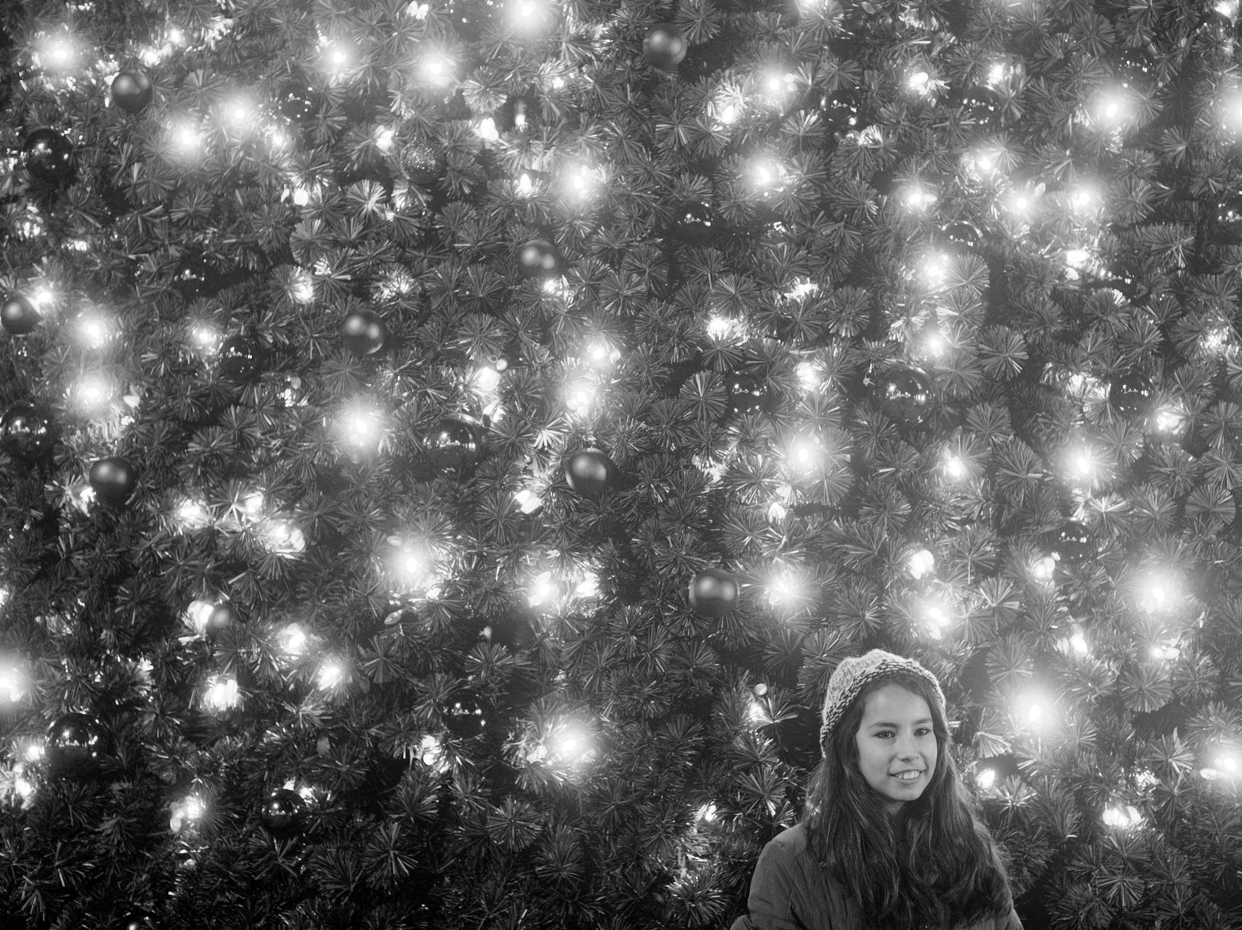 Justice Stultz-Berry poses for a photograph at the Krutch Park Christmas Tree on New Year's Eve, Thursday, December 31, 2015.