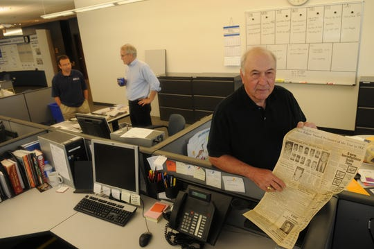 Retired KNS sportswriter Roland Julian visits the News Sentinel newsroom on  Thursday, July 2, 2009. Julian started at KNS on Aug. 29, 1957 and is now being inducted into the sportswriters Hall of Fame. At left are sports editors Phil Kaplan and Steve Ahillen.