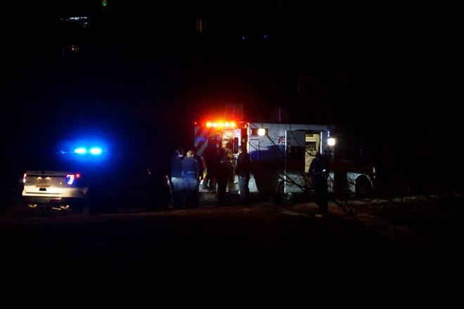 Emergency responders load a gunshot victim into an ambulance near Harbison's Crossroads on Wednesday night, Dec. 26.
