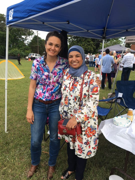 Claudia Caballero, executive director of Centro Hispano and Honduran by birth, shares a moment with good friend Fatima Ahdaoui, originally from Morocco. Ahdaoui is the YWCA's domestic violence victim advocate for refugees and immigrants. June 23, 2018.
