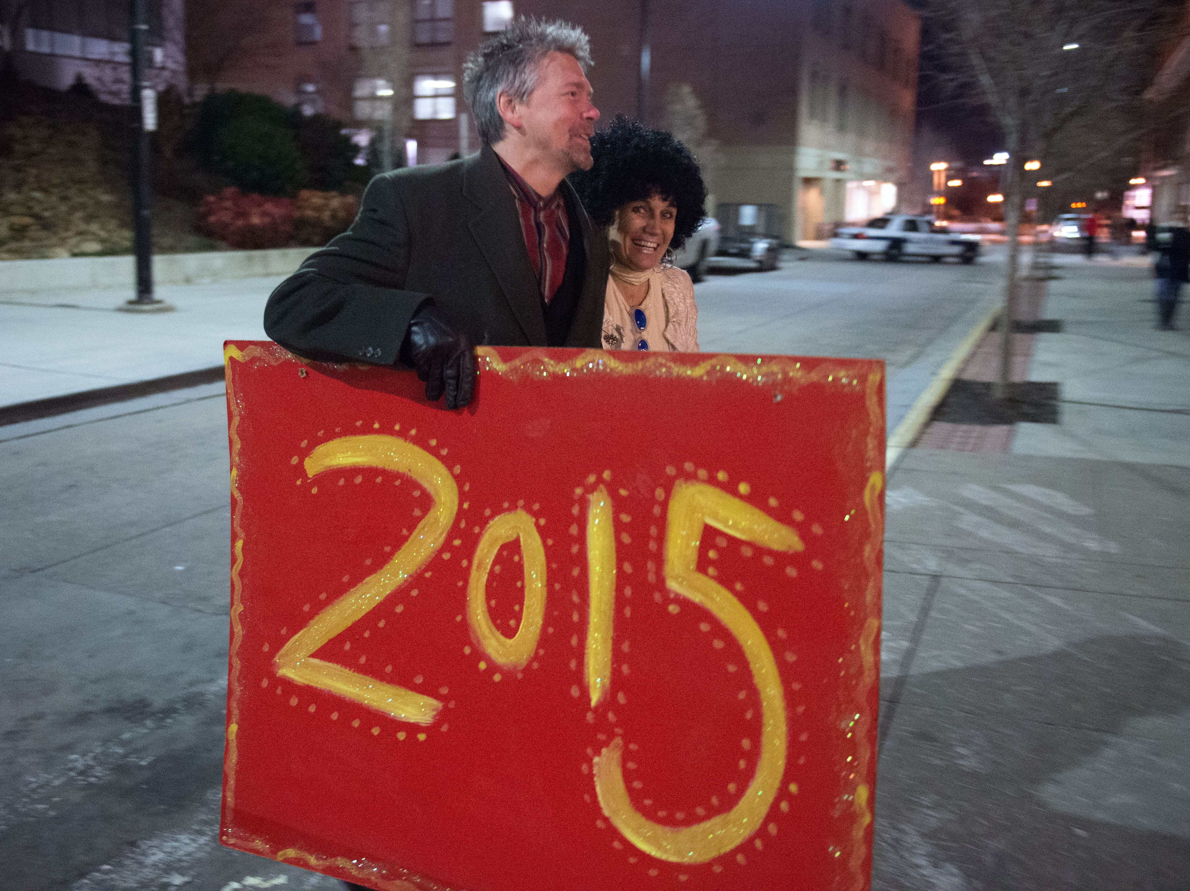 Scott and Bernadette West walk through Market Square in preparation for their New Year's Eve celebration on Wednesday, December 31, 2014.