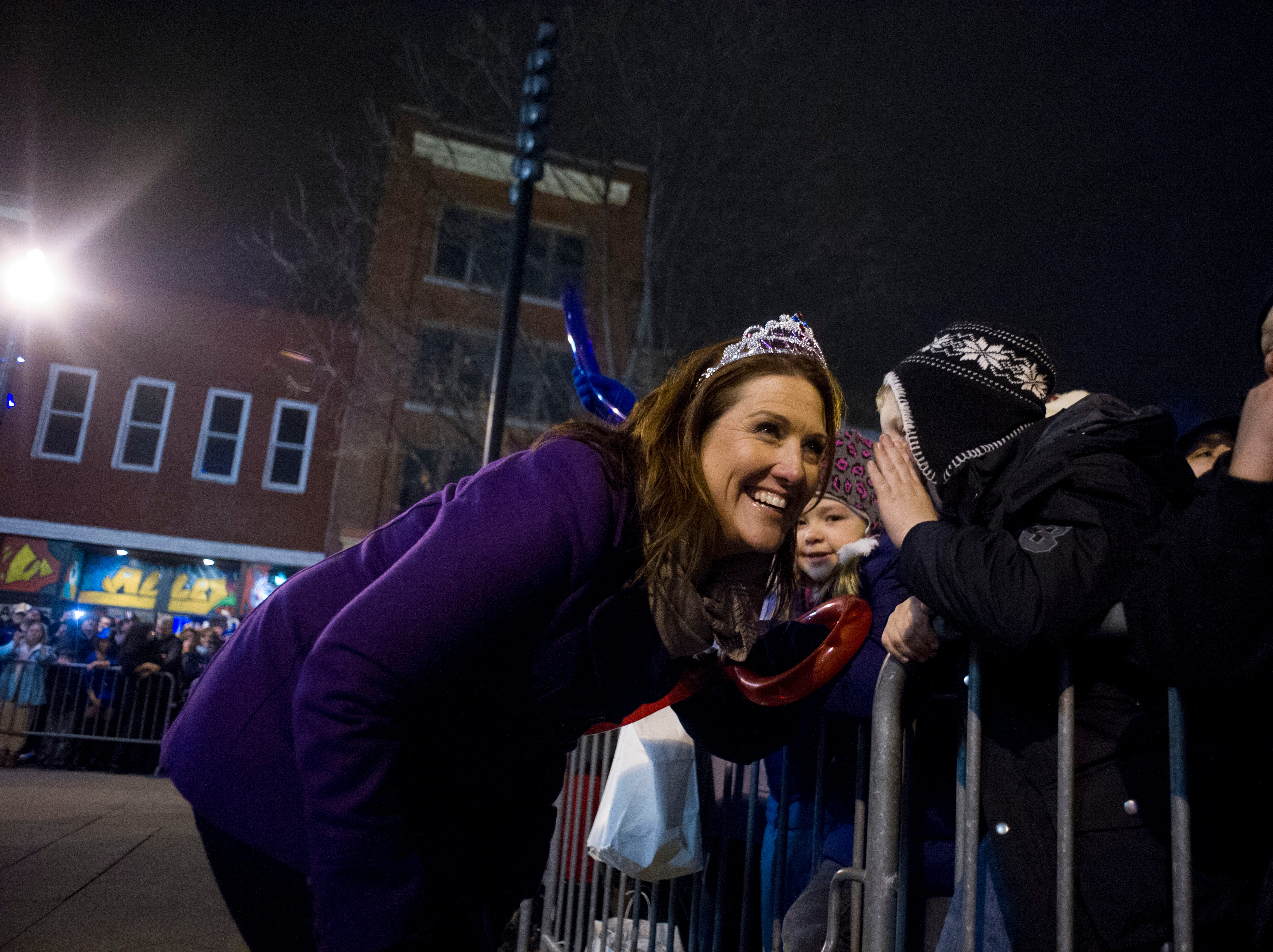 New Year's Eve emcee Erin Donovan meets with the crowd at Market Square on Monday, December 31, 2012.