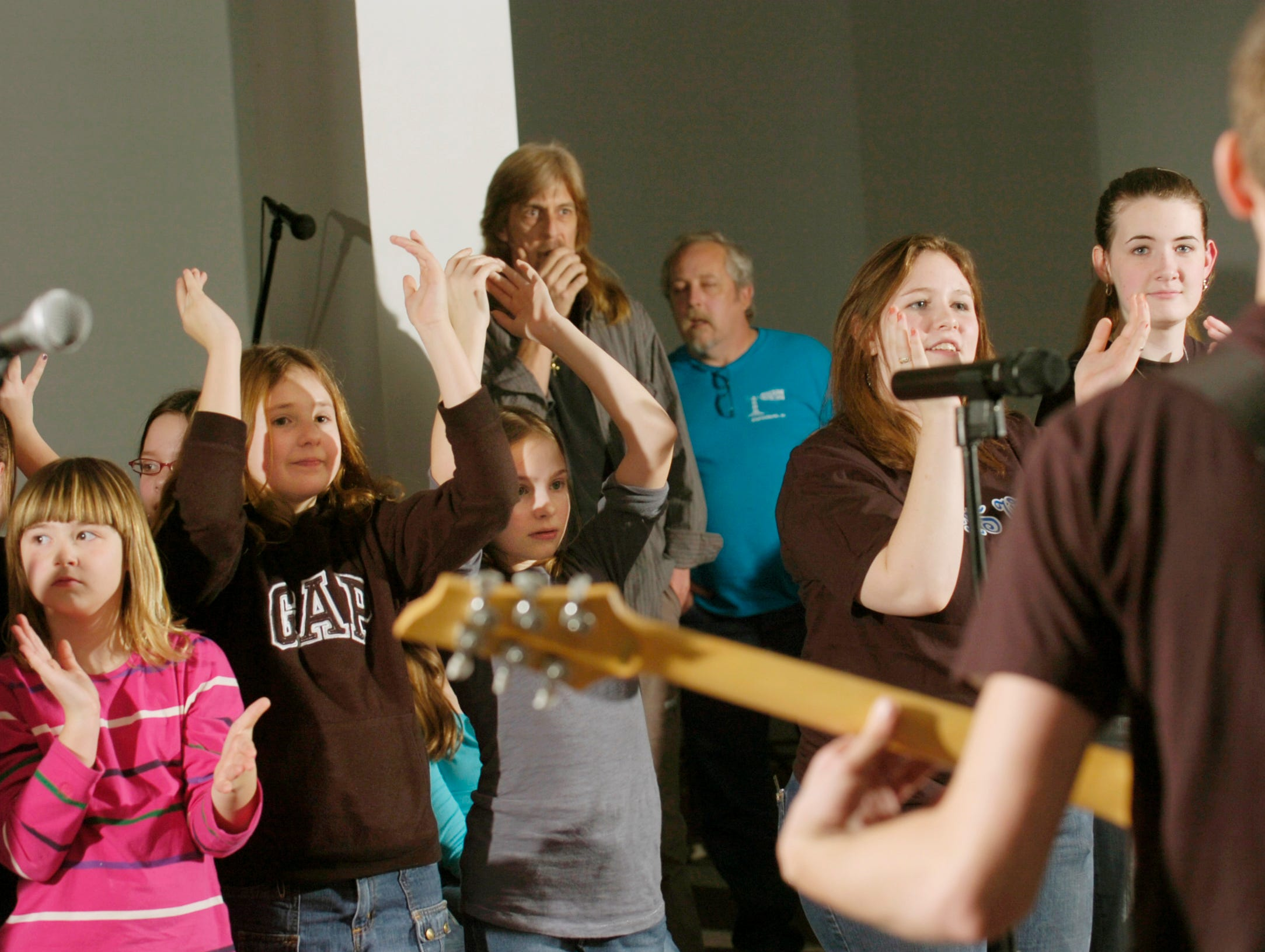 Fans rock out to Eden's Way during a New Year's eve show at Ballcamp Baptist Church.