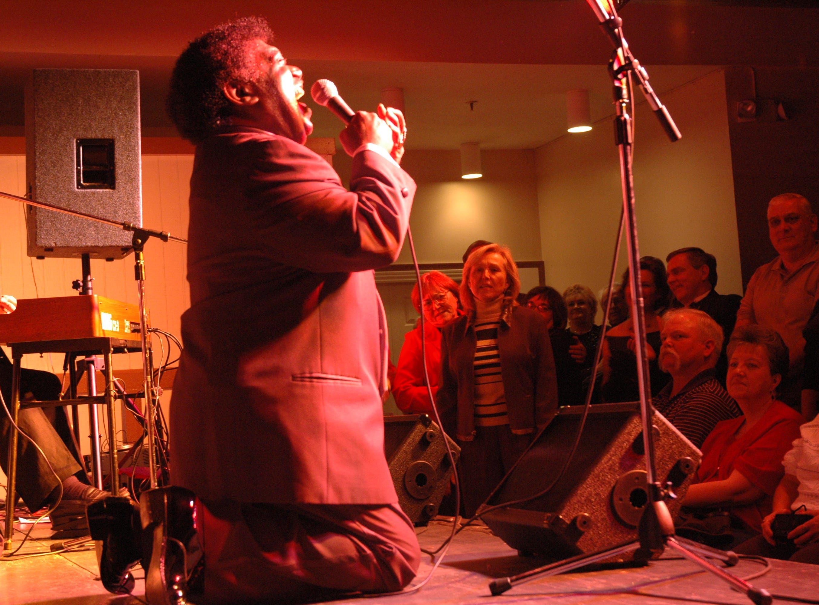 Down on his knees, rock and roll legend Percy Sledge sings with feeling and soul during a New Year's Eve party at Carson's Corner in Halls. Sledge performed two shows on Dec. 31.