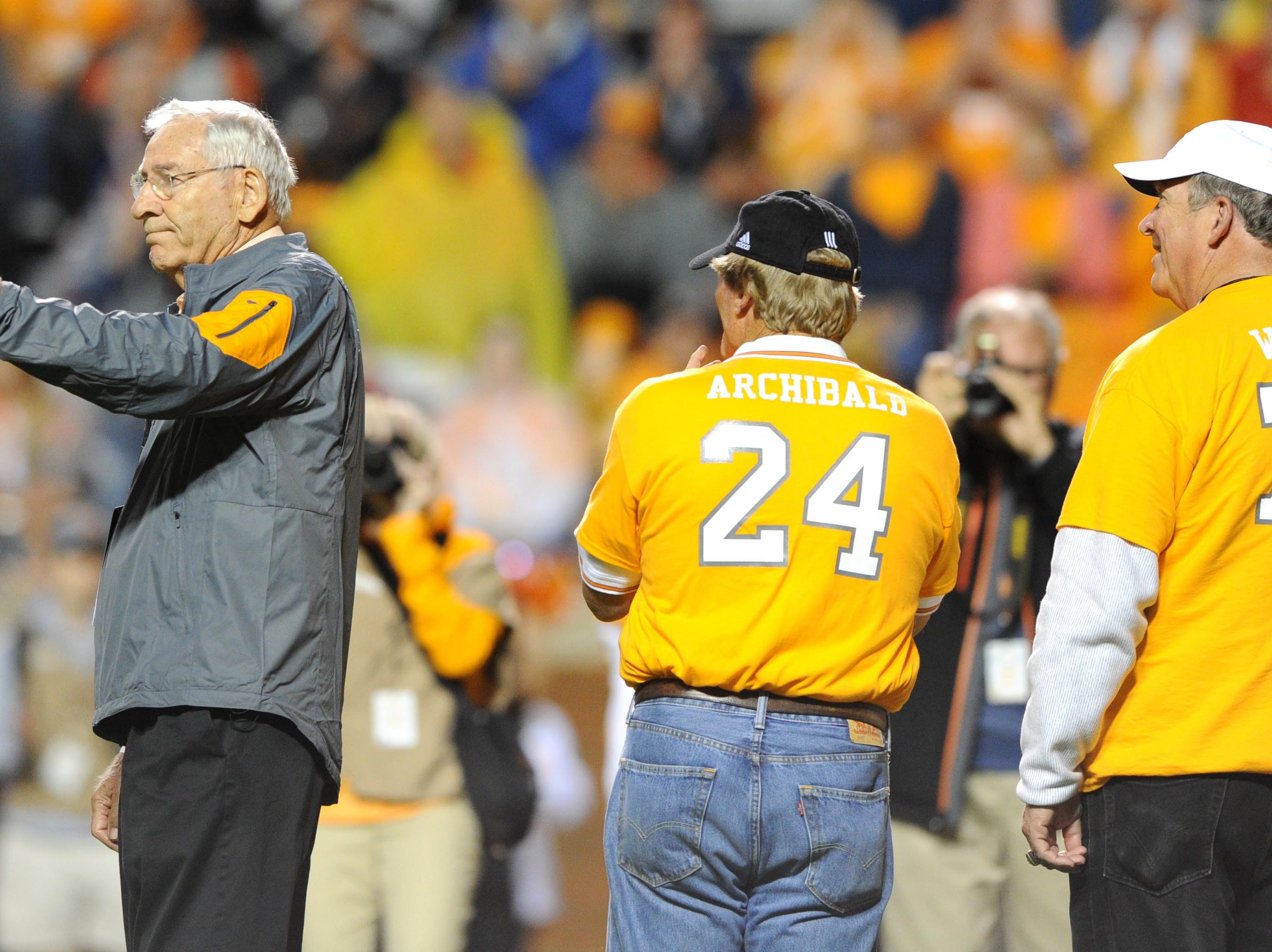 Doug Dickey, former Tennessee football coach, waves his cap to acknowledge the crowd during the first half against Arkansas at Neyland Stadium in Knoxville, Tenn. on Saturday, Oct. 3, 2015.