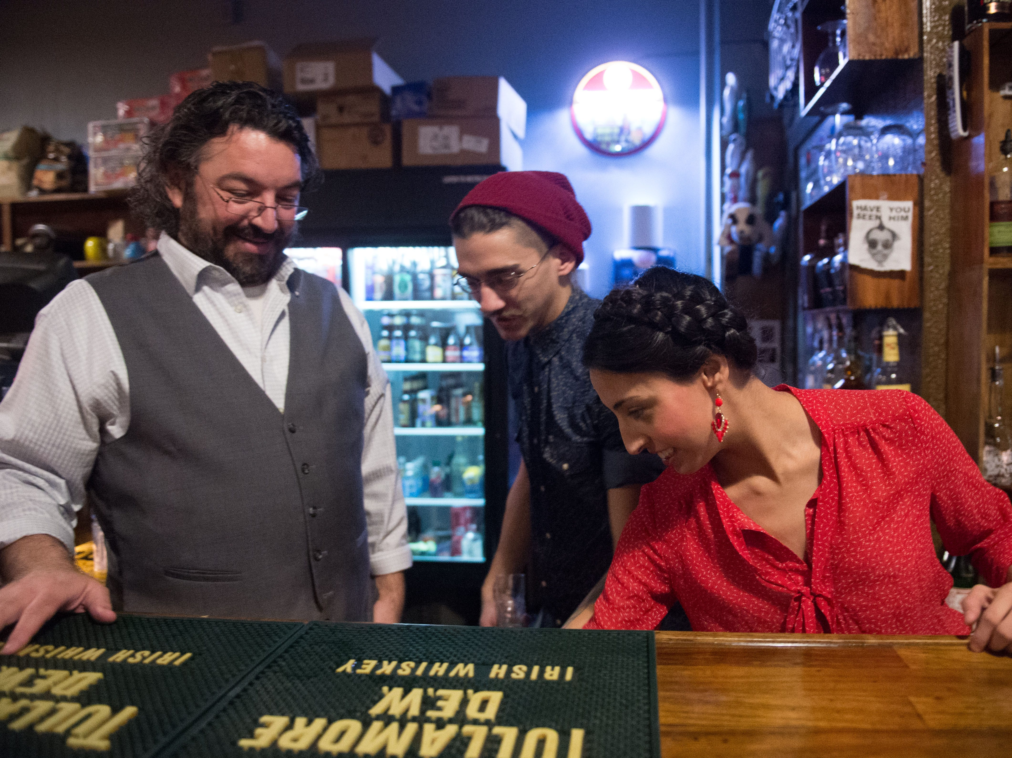 Stanton Webster, George Talley, and Katheryn Hamlett tend the bar at Suttrees on New Year's Eve.