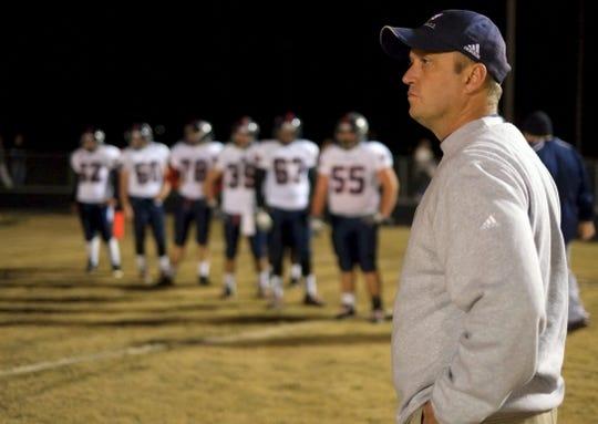 Former West High School football coach Scott Cummings during a game against Powell on Nov. 9, 2012.