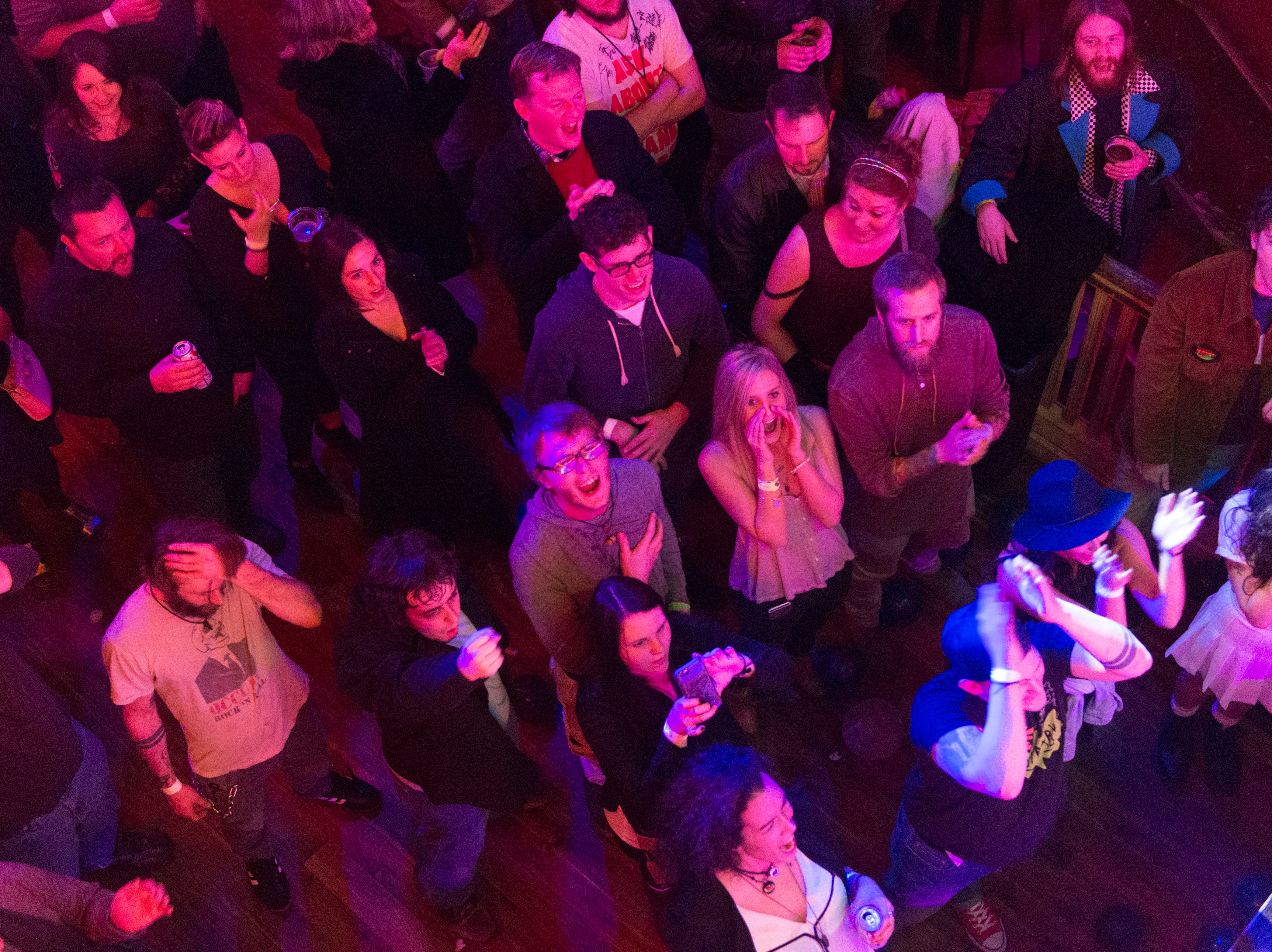 The crowd cheer on the band, Crumbsnatchers, at Scruffy City Hall on New Year's Eve, Thursday, December 31, 2015.