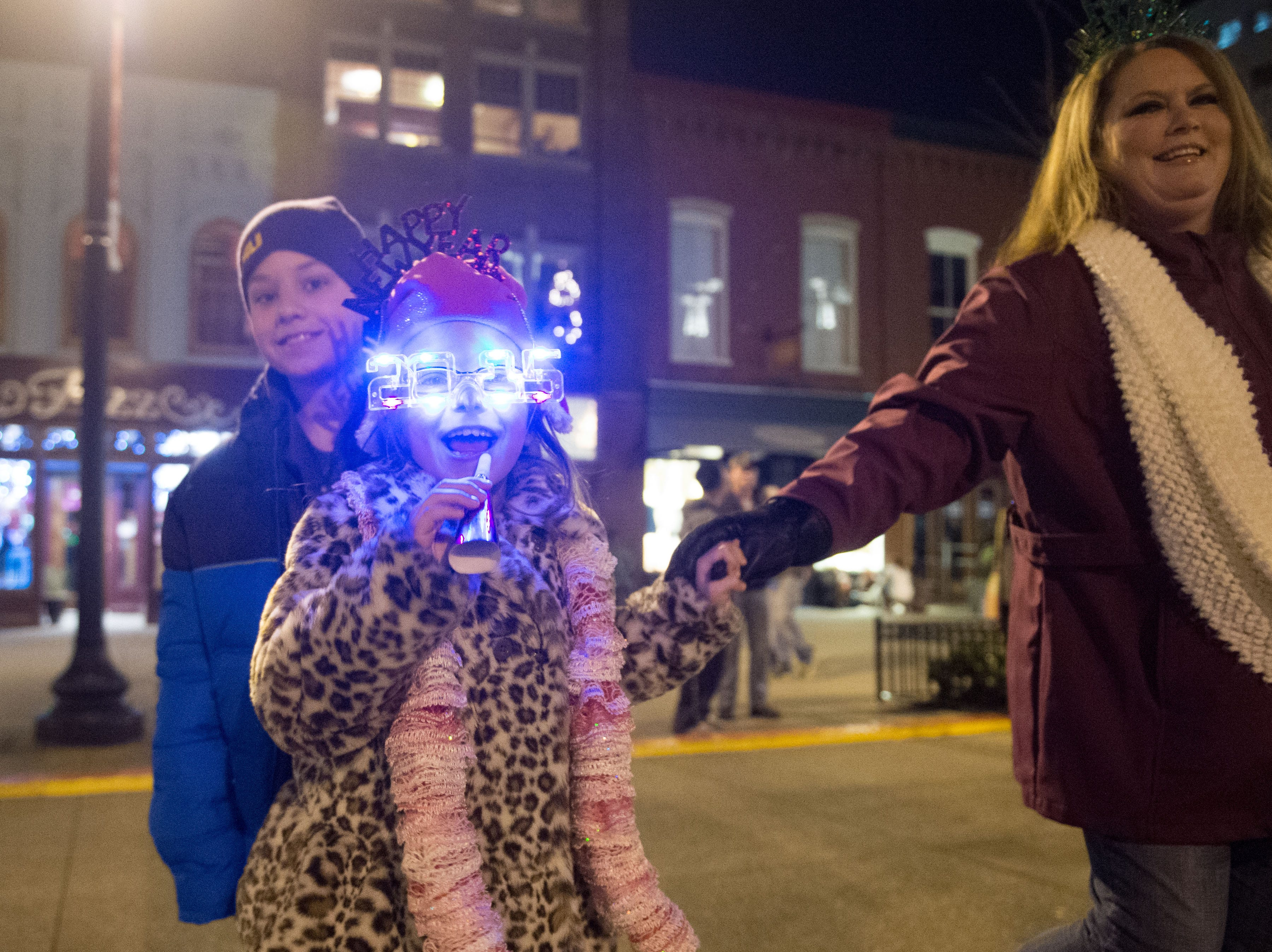 Robin Griffin and her children, Blayne, 10, left, and Bentlie, 9, celebrate New Year's Eve at Market Square on Wednesday, December 31, 2014.