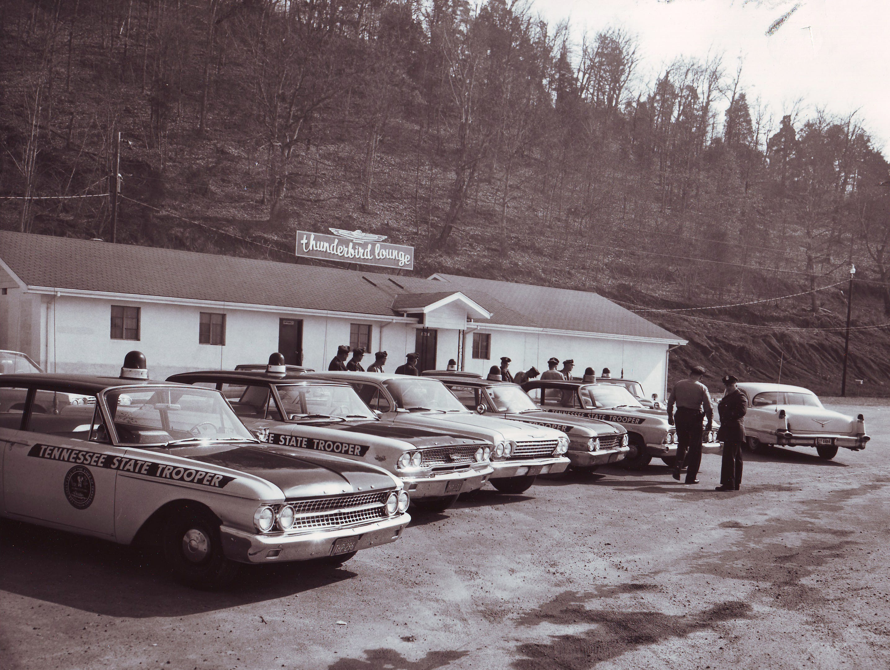 Tennessee state troopers congregate outside of a Cocke County nightspot, The Thunderbird, in early 1963. State troopers regularly raided taverns in the county during the 1960s. In one New Year's Eve operation in 1962, a team of state troopers fanned out across the county and filed charges against 32 beer joints for operating without state beer certificates.