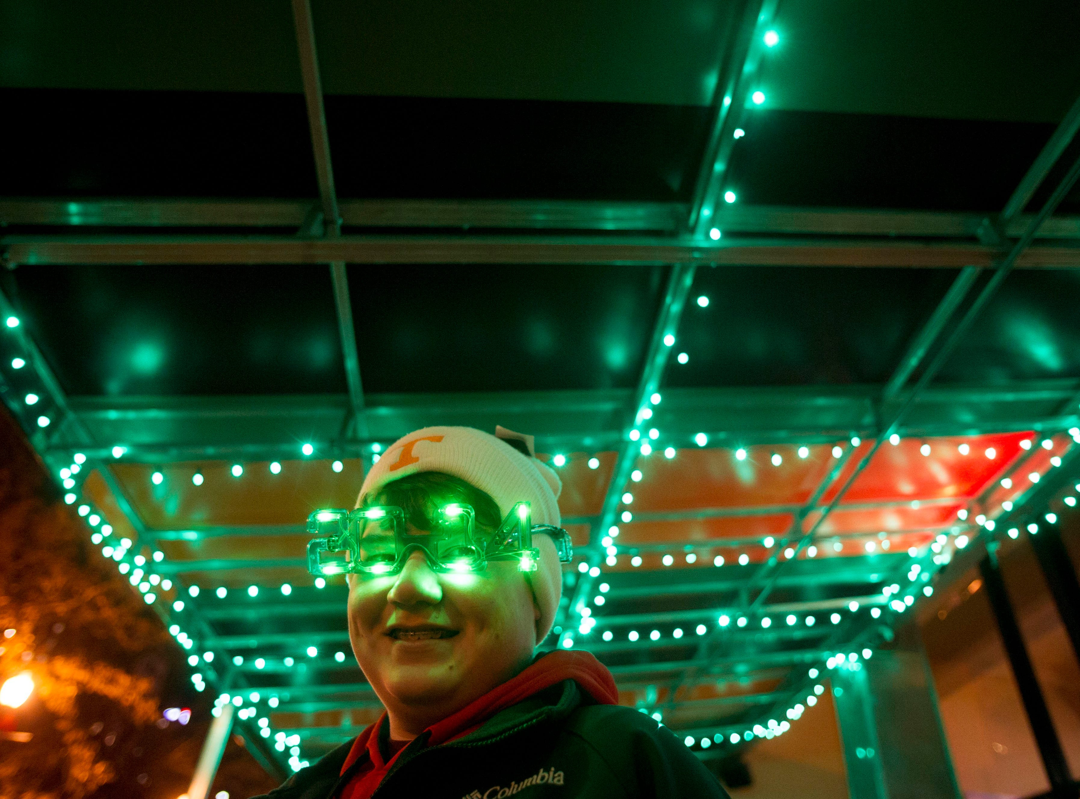 Caleb Copeland celebrates New Year's Eve at Market Square on Tuesday, December 31, 2013.