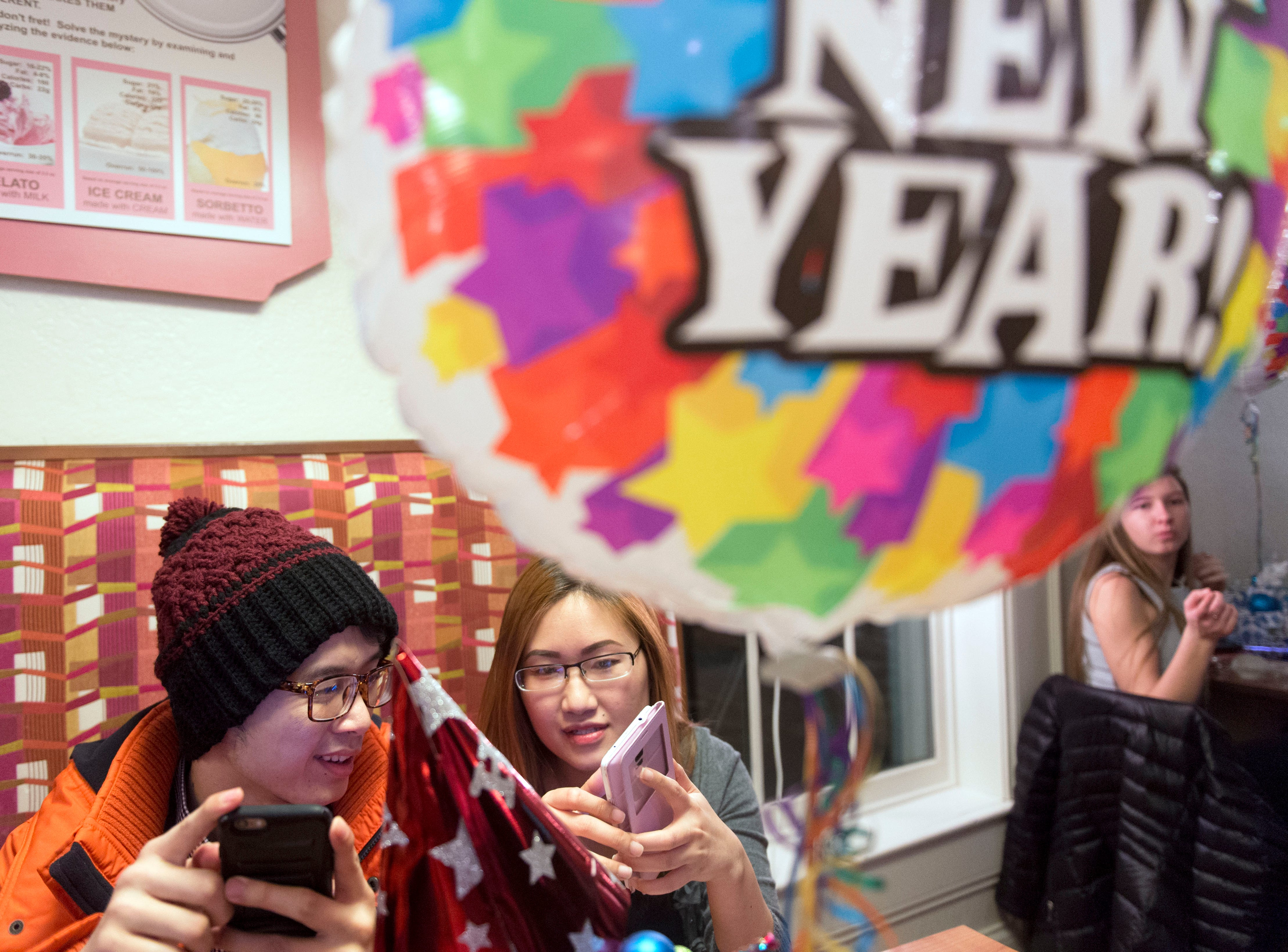 Andy Ngo and Sarah Do spend part of their evening at Collata Gelato on New Year's Eve, Thursday, December 31, 2015.