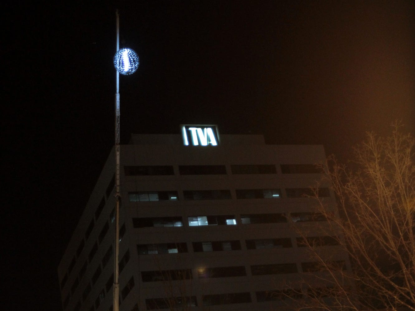 A lighted ball hangs high over the outdoor stage at the Market Square Mall during the New Year's Eve edition of First Night Knoxville on Friday, December 31, 2010. The ball will be lowered to the ground at midnight bringing in the year 2011. Photo By Justin Fee