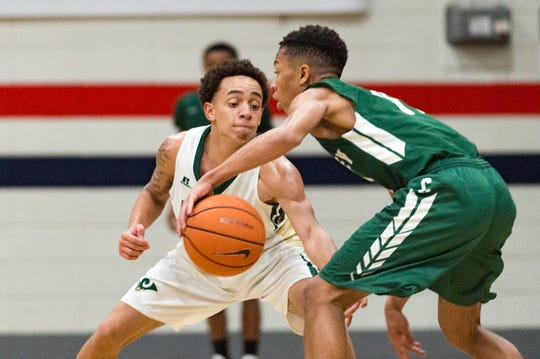 Corey Tolliver on defense as Crowley takes on Acadiana in North Vermillion High School Tournament. Thursday, Dec. 27, 2018.