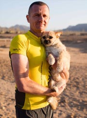 Ultramarathon runner Dion Leonard found a stray dog while running in the Gobi Desert.