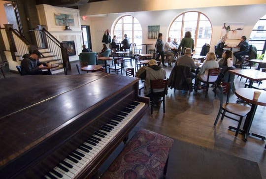 Brighton Coffeehouse and Theater gets some of its first customers, Thursday, Dec. 27, 2018.
