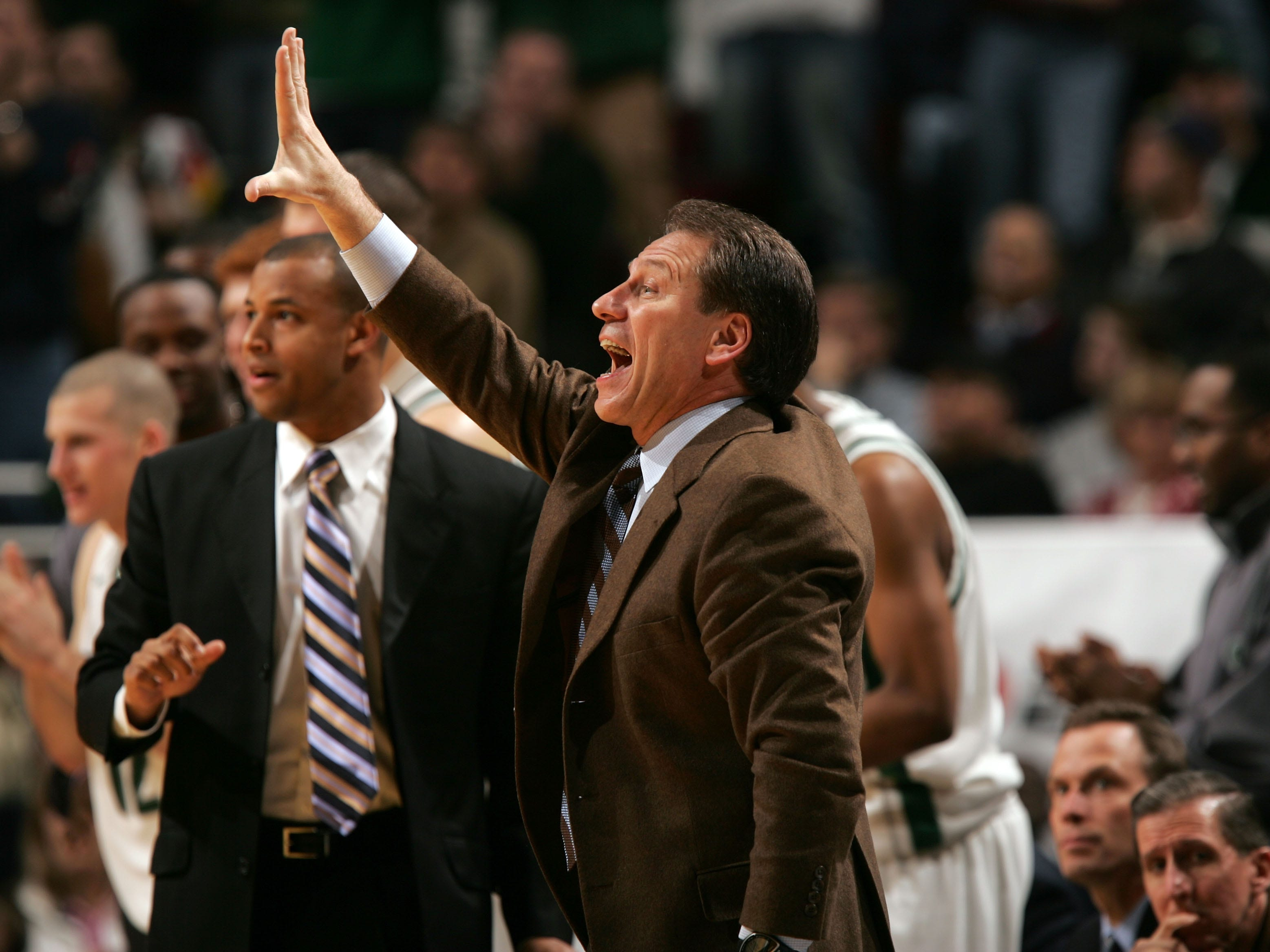Head coach Tom Izzo of the Michigan State Spartans coaches his players against the Iowa Hawkeyes during the quaterfinals on the second day of the Big Ten Men's Conference Basketball Tournament March 11, 2005 at the United Center in Chicago, Illinois. Iowa won 71-69. Assistant coach Mark Montgomery stands right next to him.