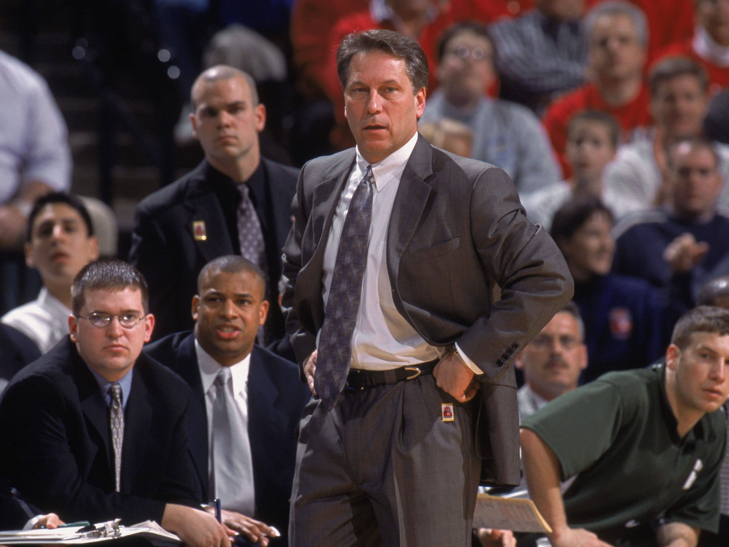 Head Coach Tom Izzo of the Michigan State  looks on from the sidelines during the BIG 10 Tournament against the Indiana Hoosiers at Conseco Fieldhouse in Indianapolis, Indiana. The Hoosiers defeated the Spartans 69-56 in March 2002. Mark Montgomery is second from left.