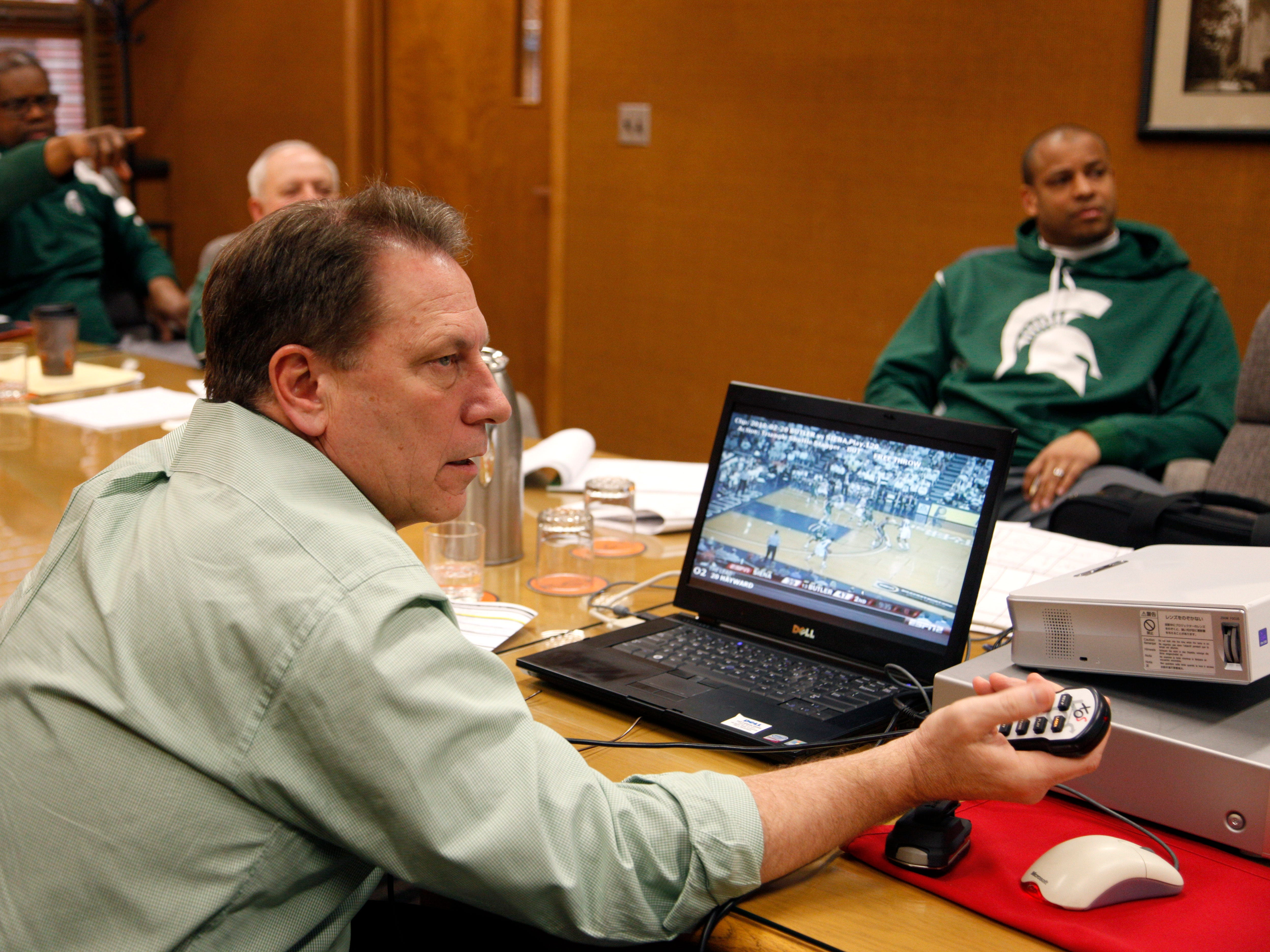 Michigan State coach Tom Izzo, foreground, and staff analyze video of Final Four opponent Butler, Tuesday, March 30, 2010, in East Lansing, Mich. Izzo is preparing for his sixth Final Four in 12 years. From left are assistant coach Mike Garland, assistant video coordinator Doug Herner, and associate head coach Mark Montgomery.