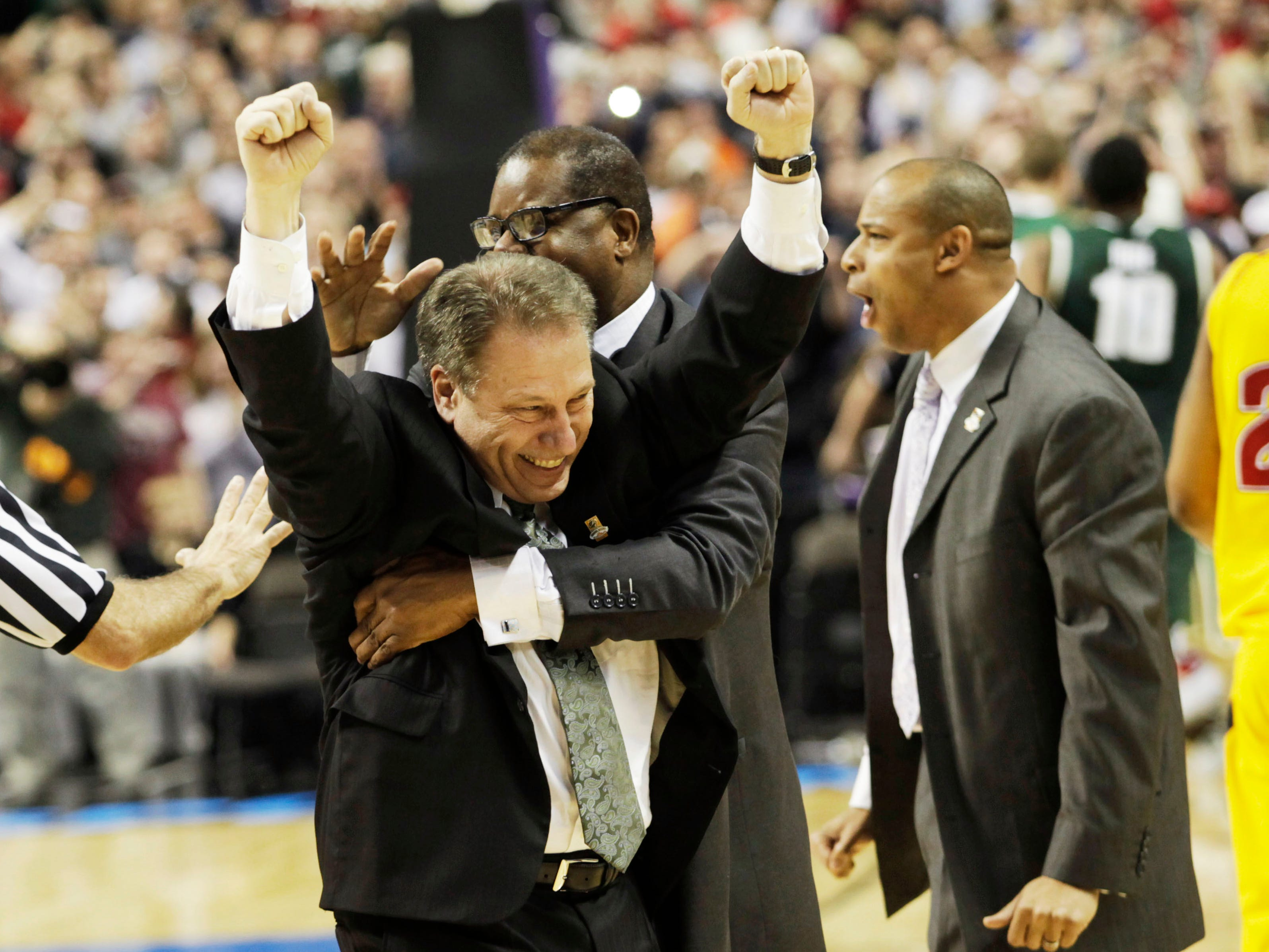 Michigan State head coach Tom Izzo, left, celebrates with assistant coaches Mark, Montgomery, right, and Dwayne Stephens, center, after Michigan State beat Maryland 85-83 in an NCAA second-round college basketball game in Spokane, Wash., Sunday, March 21, 2010. (AP Photo/Rajah Bose)