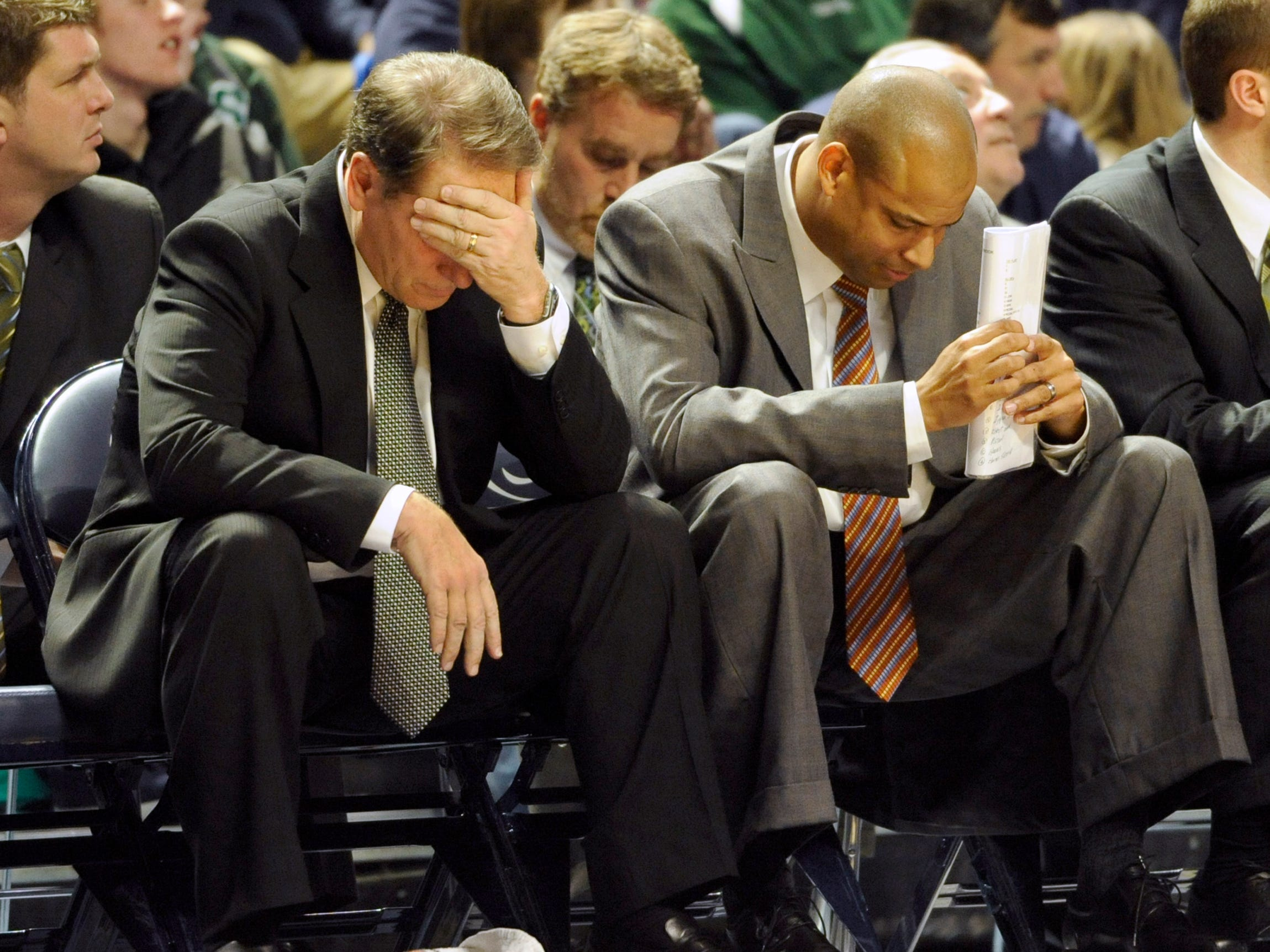 Michigan State head coach Tom Izzo, left, and associate head coach Mark Montgomery react in the second half of an NCAA college basketball game in State College, Pa., Saturday Jan. 8, 2011. Penn State defeated No. 18 Michigan State 66-62.