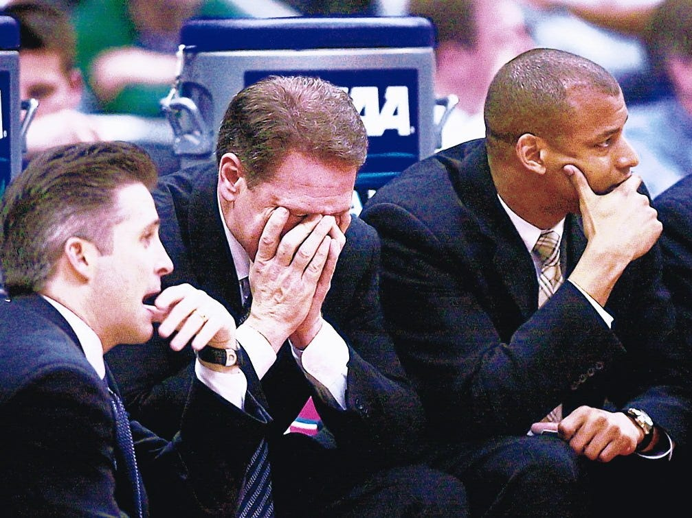 MSU coaches Brian Gregory, Tom Izzo and Mark Montgomery react on the bench Sunday night at the end of MSU's 85-76 loss to Texas in 2003.