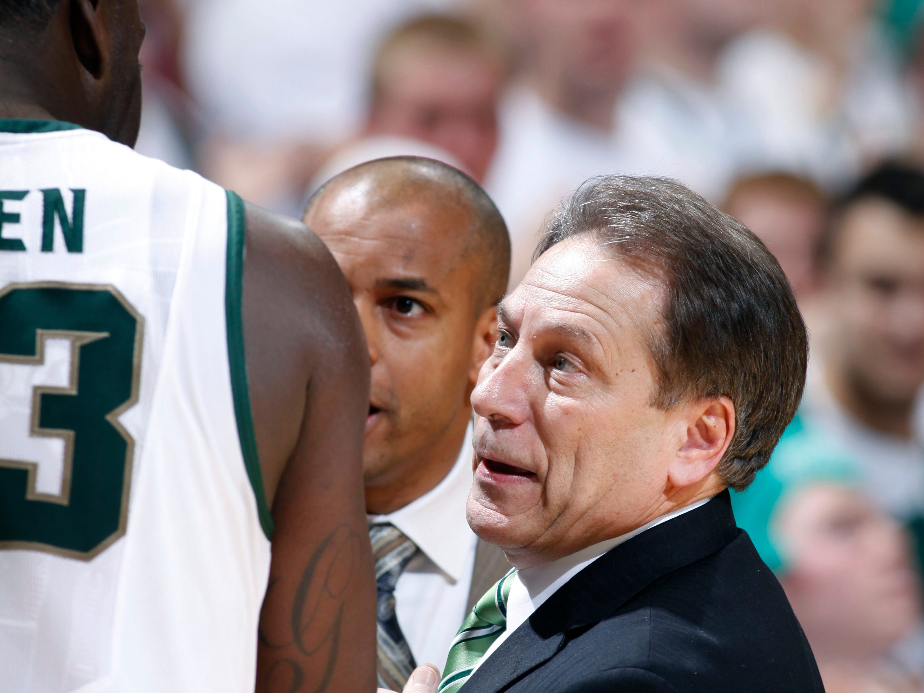 Michigan State coach Tom Izzo, right, and associate head coach Mark Montgomery, center, talk with Draymond Green during overtime of an NCAA college basketball game against Northwestern, Saturday, Jan. 15, 2011, in East Lansing, Mich. Michigan State won 71-67 in overtime.