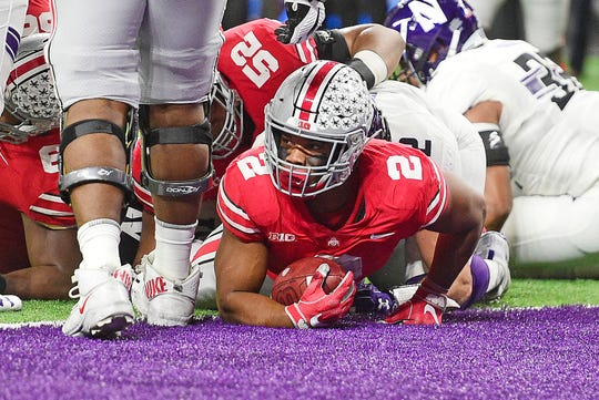 Ohio State tailback J.K. Dobbins crosses the goal line for a touchdown in the 45-24 victory over Northwestern in the Big Ten Championship Game.