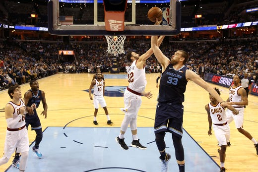Memphis Grizzlies center Marc Gasol  shoots the ball over Cleveland Cavaliers defender Larry Nance Jr. during their game at the FedExForum on Wednesday, Dec. 26, 2018.