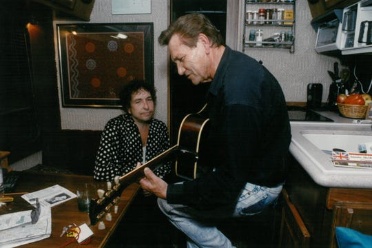 Bob Dylan listens to Sun Records great Billy Lee Riley play on his tour bus in 1992.