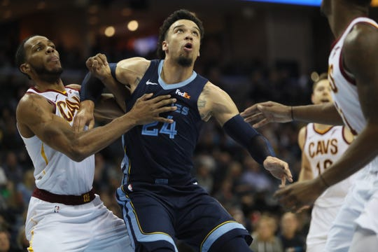Memphis Grizzlies guard Dillon Brooks fights for a rebound with Cleveland Cavaliers defenders during their game at the FedExForum on Wednesday, Dec. 26, 2018.