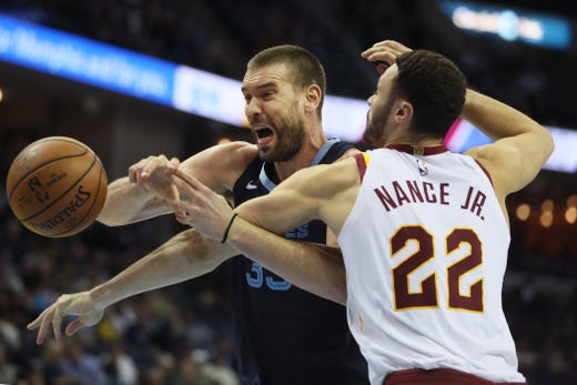 Memphis Grizzlies center Marc Gasol battles Cleveland Cavaliers defender Larry Nance Jr. for a rebound during their game at the FedExForum on Wednesday, Dec. 26, 2018.